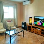 """Living room, AC and 50"""" SmartTV"""